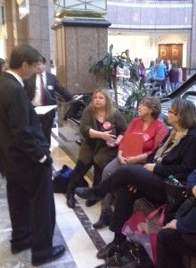 Rep. Mike Demicco, a member of the Public Health Committee, takes time to listen to the concerns of families